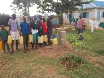 2015 - Collecting piped water from tap point by dormitories