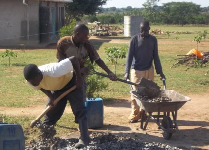2014 - Local employment - Young men doing their manual labour thing assisting with the water tank stand construction.